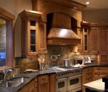 Rustic Kitchen Design With Pro Viking Range, Large Wood Hood, And